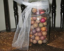 Antique painted clay Marbles  circa 1800's - 1930's in a wheaton small glass canning jar