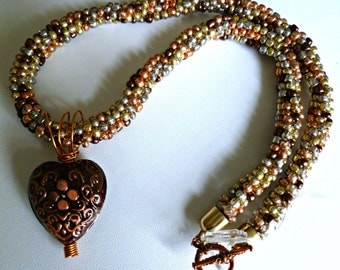 Beaded Kumihimo necklace, copper multi with metal engraved heart
