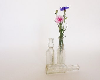 Set of 3 VINTAGE GLASS  BOTTLES , use to decorate your house, collect,anything you can imagine.