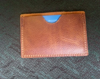 Price reduced for Fathers Day, Minimalist Leather wallet credit card holder with a pocket on each side for cards and cash,thin,nice leather!