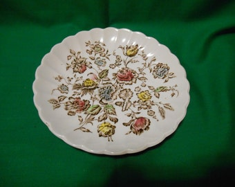 """One (1), 5 3/4"""" Tea Cup Saucer, from Johnson Bros., in the Staffordshire Bouquet, Brown Multicolor Pattern."""
