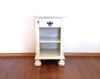 vintage distressed white nightstand. chippy paint table. retro furniture & home decor.