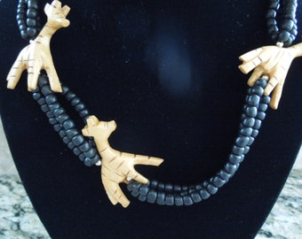 Vintage Animal Necklace.  Giraffes in Wood on a Black Bead Necklace.  30 Inches Long