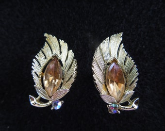 Vintage Lisner Earrings.  Screw Back Type.  Gold Toned Leaves with Central Amber Rhinestone.  Pretty