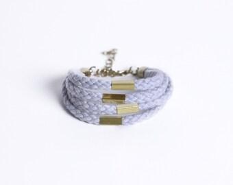 Light grey braided bracelet with beads