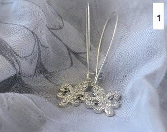 Silver earrings with fleur de lis, sol key or starfish pendant