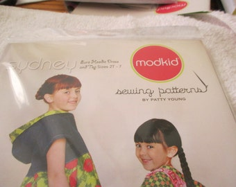 modkid sewing pattern for a Sydney top and dress (no pants) in sizes 2T-7 by Patty Young