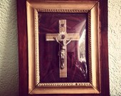 Vintage antique wooden frame with religious catholic old jesus crucifix wallhanging decor wall