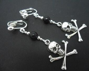 A pair of tibetan silver skull crossbones & black bead dangly clip on earrings.