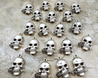 Set of 20 Pewter *Guns And Roses* Skull Biting Rose Charms - 5200