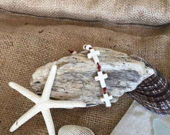 leather and white halocite cross bracelet