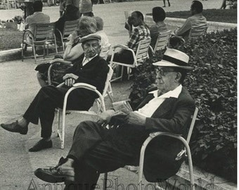 People resting in bay park marina vintage art photo by L. Solomon