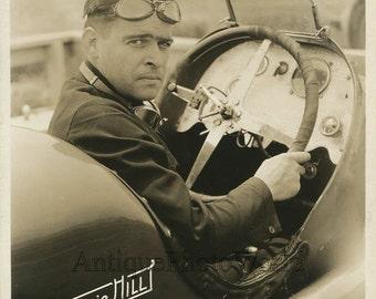Handsome car racer Bennie Hill in automobile antique photo