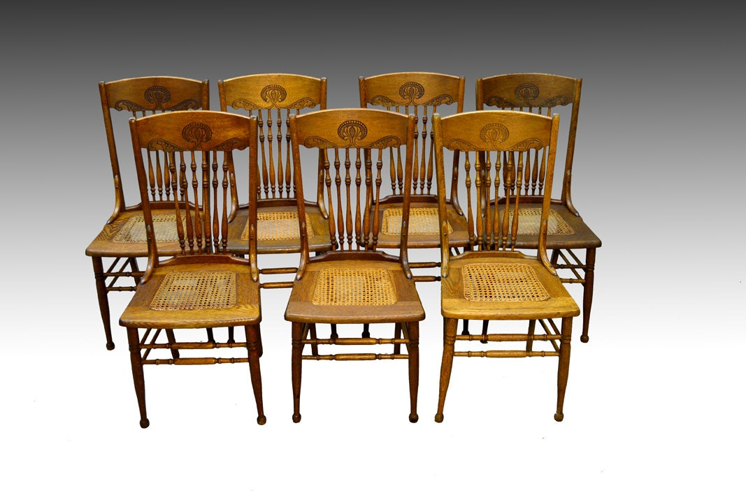 Antique set of oak press back dining chairs