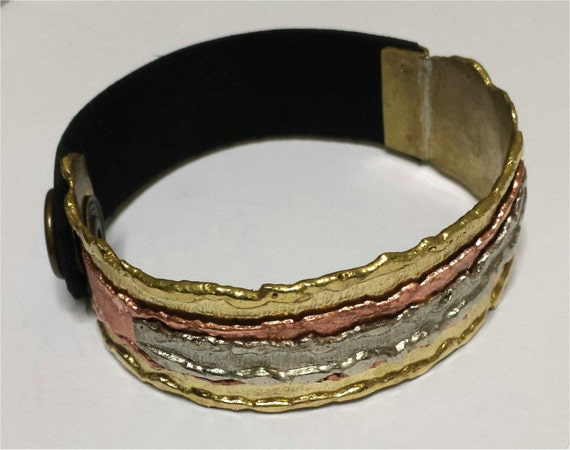 Brass bracelet hand forged with copper and german silver