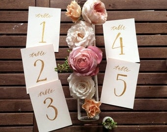 Gold on Blush Hand Painted Table Numbers // Wedding and Party // Pink and Gold