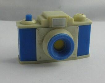 Souvenir from Bad Bramstedt (Schleswig-Holstein, Germany). Plastiskop, Plastikop, Gucki, mini TV. Form of a camera. Probably 50s. VINTAGE