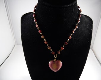 Vintage mother of pearl heart beads with matching hear pendant.