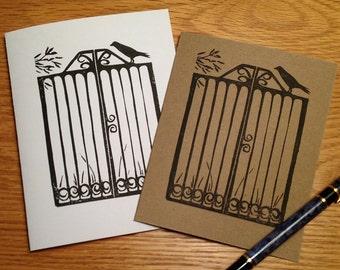 Crow on garden gate linocut block print card