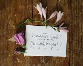 Modern calligraphy style hand lettered custom addressed envelopes