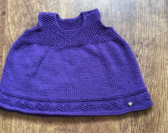 Hand knitted baby pinafore 0-6 months