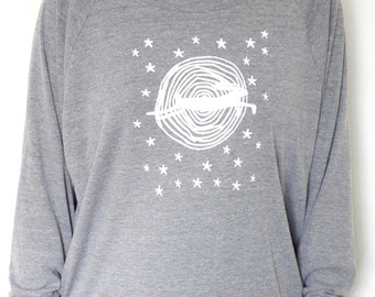 A grey ladies sweat shirt with a hare jumping across a moon and stars