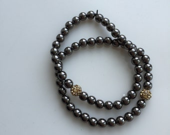 Set of two black and gold beaded bracelets