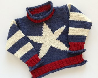 Hand knitted - baby jumper in dark blue, cream and red, with star detail
