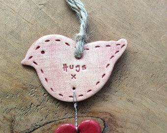 Hugs bird with heart, hanging ceramic gift/decorative item handmade in Wales