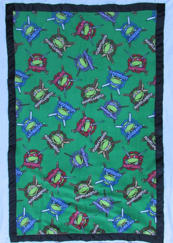 Ninja Turtle fleece toddler blanket with satin edge