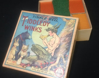 Tinkle Bell Tiddledy Winks Board Game. Pan playing pipes edition. Includes box, chips, felt, cup.  Vintage Parker Brothers.  Tiddlywinks.