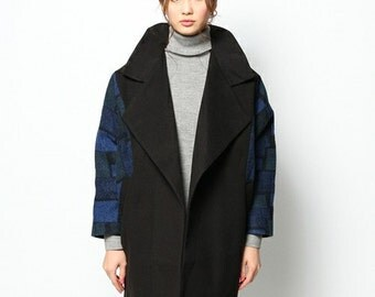 Liquorish black coat with blue brick sleeves