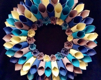 "17"" Dahlia style paper wreath with rosette center in shades of blue/aqua/lime green/tan"