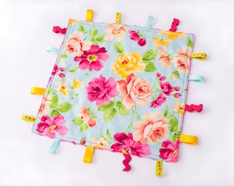 Summer floral baby taggie blanket with fuchsia dotted minky back