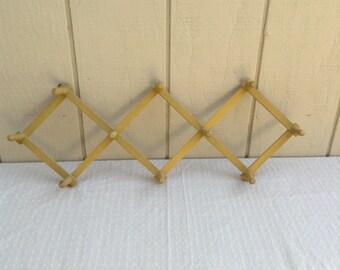 Vintage Wood Accordian Wall Rack.