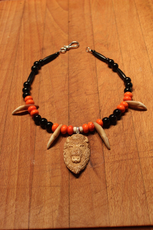 Wolf Tooth Necklace 19 Carved Bone Buffalo Head Pendant1000 x 1500 jpeg 337kB