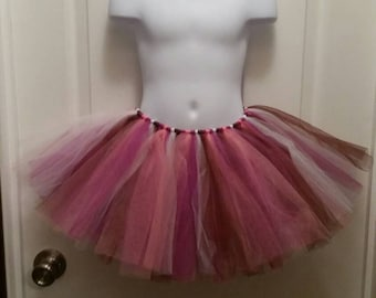 On sale now! Tutu size 4T-6T. Great for photo props or dress up.