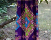 Psychadelic 1970's maxi skirt with bright green, teal, pink, and orange patterns