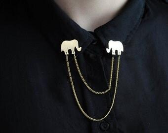 Pins de latón con forma de elefantes