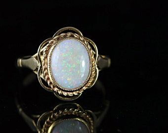White opal ring in 9 carat gold vintage ring for her