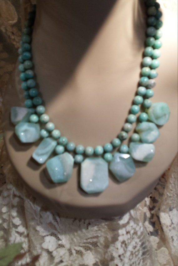 Two strand beaded necklace with druzy teardrops
