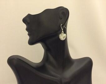 Charming heart shaped dangle earrings
