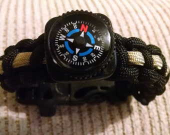Paracord survival bracelet with compass, whistle, flint and firestarter