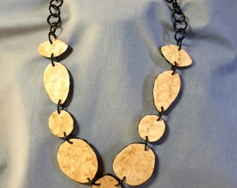 Handcut birdseye maple necklace