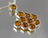 HONEYCOMB silver pendant with amber and white sapphires
