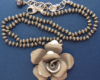 Hand knotted sterling silver beads and Hill Tribe rose pendant necklace