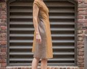Asymmetrical cut scoop neck dress in Japanese wool knit • Merino knit yellow and bronze stripe blocked dress • Raglan sleeve dress