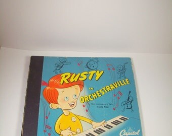 Vintage Collection of RCA Victrola Record Recordings from the 1930s in a Rusty Capital Book