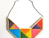 Geometric bib necklace hand embroidered bright primary colors orange purple yellow red green and blue modern embroidery An Astrid Endeavor