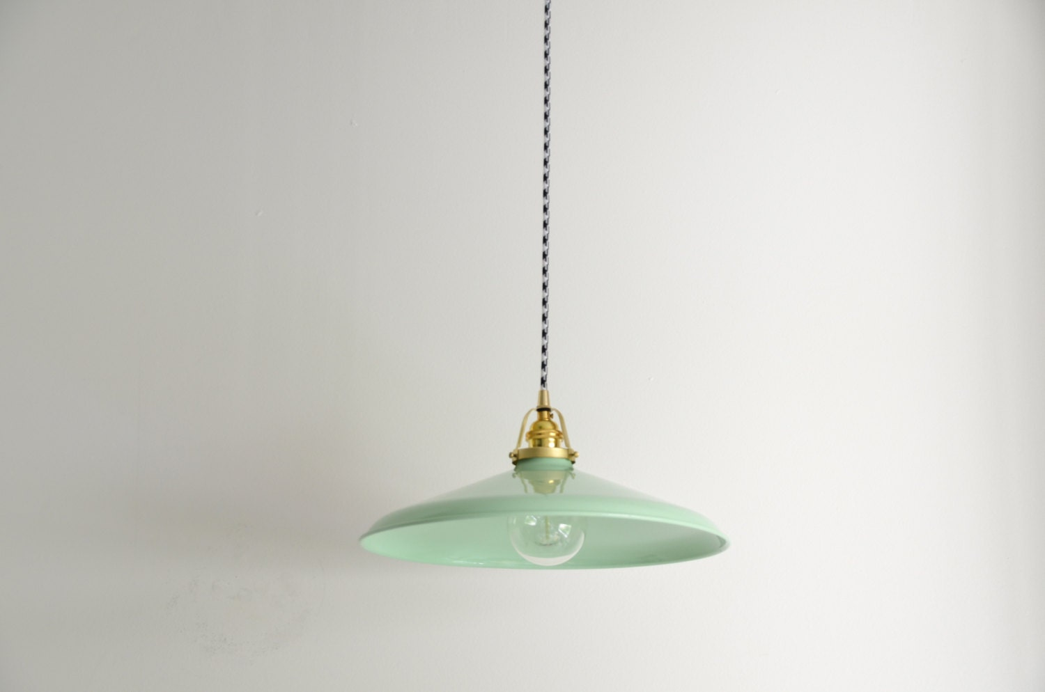 mint green brass pendant light with a houndstooth cloth